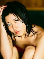 Lovely asian hottie is enthralling in her little bikini