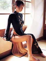 Sexy asian babe shows off her gorgeous long legs in a dress