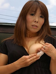 Japanese MILF strips and teases pussy
