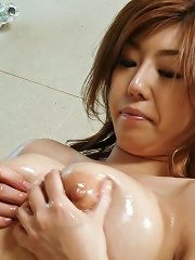 Big titty Naho Hadsuki with big oiled tits toys her pussy