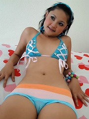 Cute Thai girl with braces named Febe strips out of her bikini