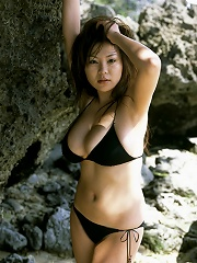Very big breasted gravure idol has her large melons in a bikini