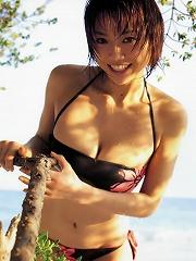Busty asian babe is erotically beautiful in her printed bikini