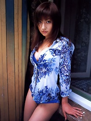 Stacked and gorgeous asian babe with big bouncy tits in a bikini