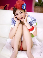 Sensual asian cutie looks adorable in her tiny red hat
