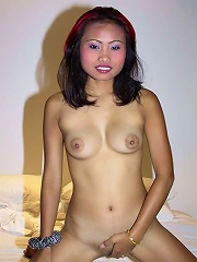 Thai slut with red hair shows her nice boobs and tight pussy
