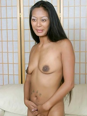 Amateur asian babe spreads her legs wide to show her wet twat