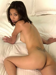 Long haired asian beauty showing her horny body on her bed